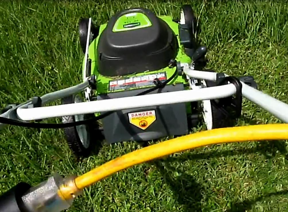 greenworks electric lawn mower in action